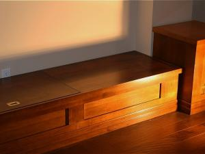 Bench designed to balance wall unit and entertainment centre versatility and style in custom designs by Reeces
