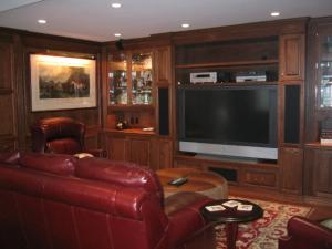 This lovely room contains a library and entertainment unit. The beautiful wood panelling and wall units enhance the owners enjoyment