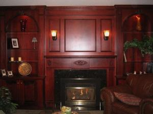 Rich-stained cherrywood wall unit, granite surround