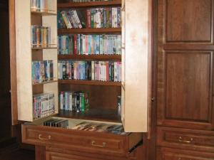 Libraries of books and movie collections are stored in these elegant units.
