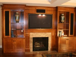 Arts-and-Crafts style wall unit, with elegant woodworking and clean simple lines.Side units incorporating Speaker Cabinetswith buil- in speakers frame the shelving