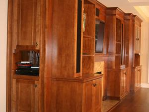 Hidden storage shelves for a superb sound system and home theater