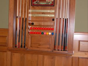 Built-in pool cue storage unit, perfect for all of your entertainment needs