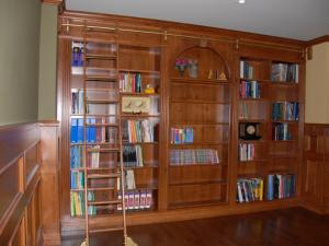 Notice the grip in the centre section of this library unit. This is the secret access door to the room behind the wall.  Panic rooms and secret panel accesses to safes and secure areas are one of Reece's specialties.