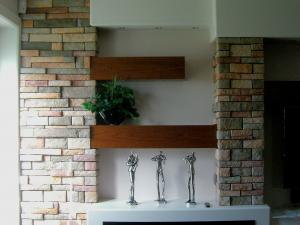 Contemporary electric fireplace combines cherry wood and stone elements--designed, built & installed by Reece's
