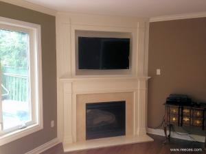Custom-built TV & fireplace by Reece's