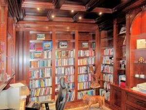 Cherrywood panelled library with coffered ceiling