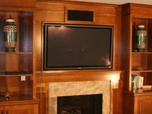 Arts-and-Crafts fireplace and entertainment unit, the warmth of maple with modern sleek lines