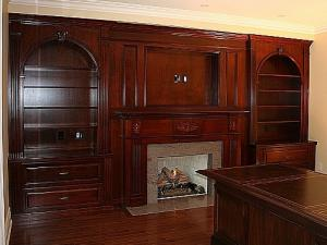 Reece's home office design with built-in fireplace