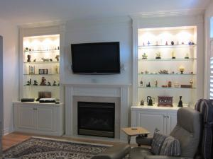 Wallunits on both sides of TV over Fireplace Ample lighting for collectors