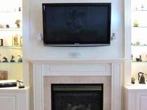 TV sits cleanly on the wall in this contemporary TV over Fireplace. Clean lines are a characteristic of Contemporary Styling