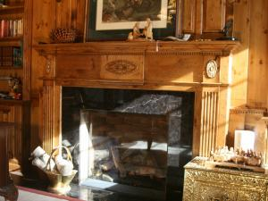 Fireplace surround in distressed, antique pine