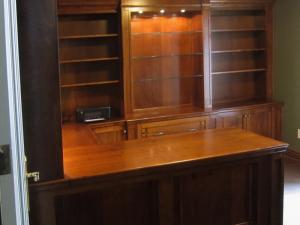 Horseshoe-style home office in maple, perfectly designed and ready for installing this client doctor's multiple computer monitors and diagnostic equipment