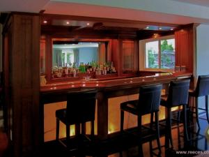 Cherry wood bar with translucent onyx panel and countertop