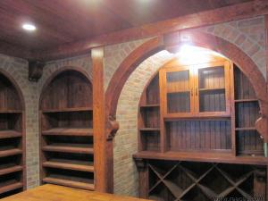 Wine Cellar in antiqued distressed and glazed finish on knotty pine, angled shelves for easy identification for the wine aficionado