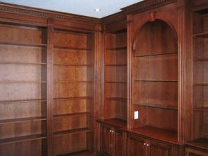 Shelving in rich wood stain designed to suit the owners' needs