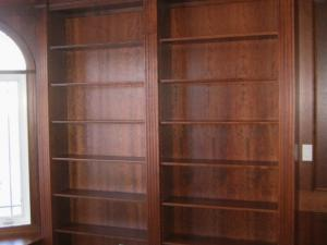 Shelving in rich wood stain designed to suit the owners' specific requirements.