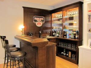 Oak bar in the Arts & Crafts style on display in Reece's showroom
