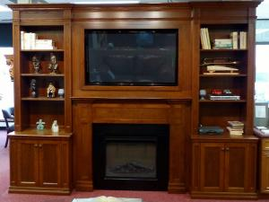 Beautiful maple wall unit with TV and fireplace inserts