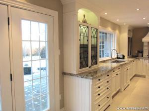 Spacious, bright and elegant - featuring glass-panel upper cabinet