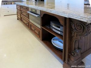 Island providing additional storage and warming drawer