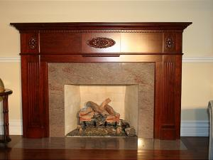 Simple and beautiful, the richly stained cherrywood enhances the veins in the granite surround.