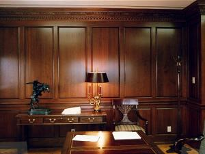 Reece's custom home office features solid cherrywood panelling with a hand-carved crown.