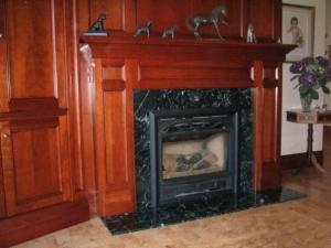 Cherrywood Panel Fireplace Designs by Reece's Craftsmanship serving Newmarket, Aurora, Toronto, Oakville, Markham and the GTA
