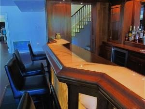 Back-lit onyx panels at the bar front and on the bar top Reeece's beautiful home renovations: Innovation and Style