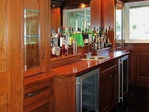 Wine cooler & dishwasher built into home bar, the custom mill-work, beautiful design and attention to detail make this home renovation a showpiece, a must for entertaining.