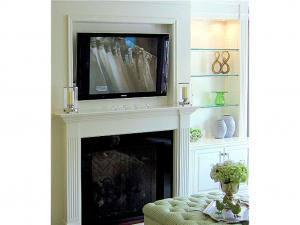 Sublime elegance, television over fireplace. Elegant custom home renovations by Reeces.