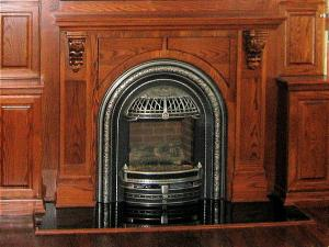 Focal point of room is this Valor fireplace. Set into a traditional bracket mantel with the TV above