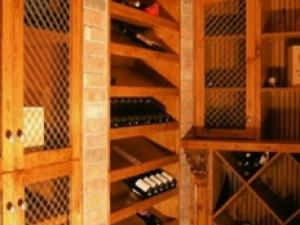 Classic wine cellar has angled shelving for easy identification--for the wine afficiando. Finer styling for finer living with Reece's custom designs