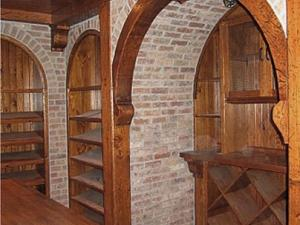 Wine Cellar in antiqued distressed and glazed finish on knotty pine. This is Reece's specialty and his designs have been featured in architecture magazines