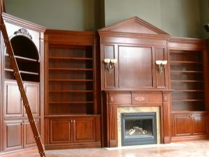 Fireplace mantel,wall unit and library custom-designed to suit 14' ceiling in this grand library Cherry Wood Wallunits grace this custom designed home