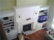 "Fireplace mantel, wall unit and TV enclosure custom designed to suit 14"" ceilings, white lacquer finish, custom designed by Reece's"