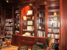 Cherrywood breakfront wall unit incorporated in a panelled library