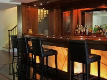 Arts & Crafts style bar with back-lit onyx panelling Reeece's beautiful home bars - custom designed and built for you