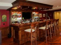 Large basement bar suitable for entertaining large gatherings.