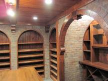 Angled Shelves for easy identificatin of collector wine bottles Reeece's designs are both practical and beautiful