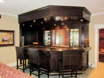 Cherrywood bar in a dark stain incorporates a waterfall feature on the back wall.