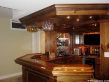 Note the detail - television, wine fridge, bar sink, glass racks, lighting and the detail in the posts, panelling and coffered ceiling.