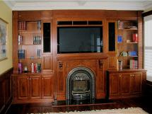 Focal point of room: Valor fireplace with television above. Construction is in oak, stained and lacquer finished
