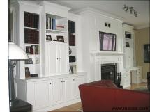 Wall unit with TV above fireplace, white lacquer finish